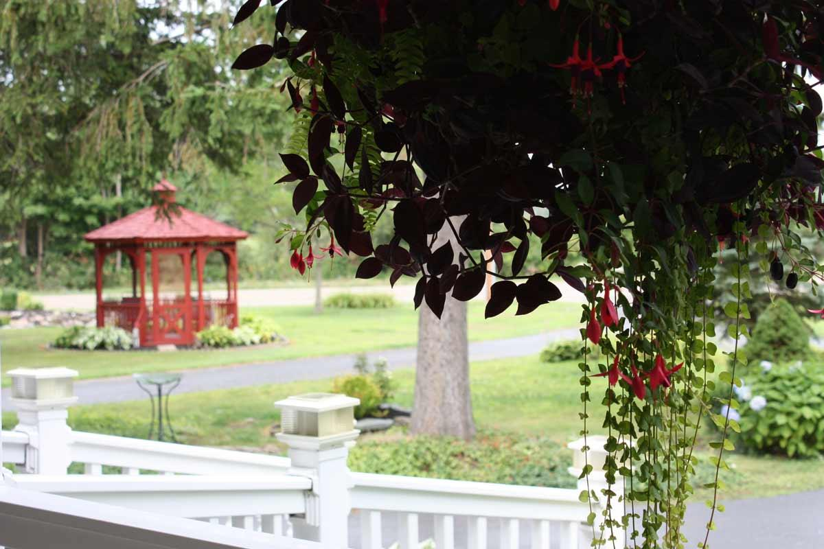 red gazebo from the view of the front porch